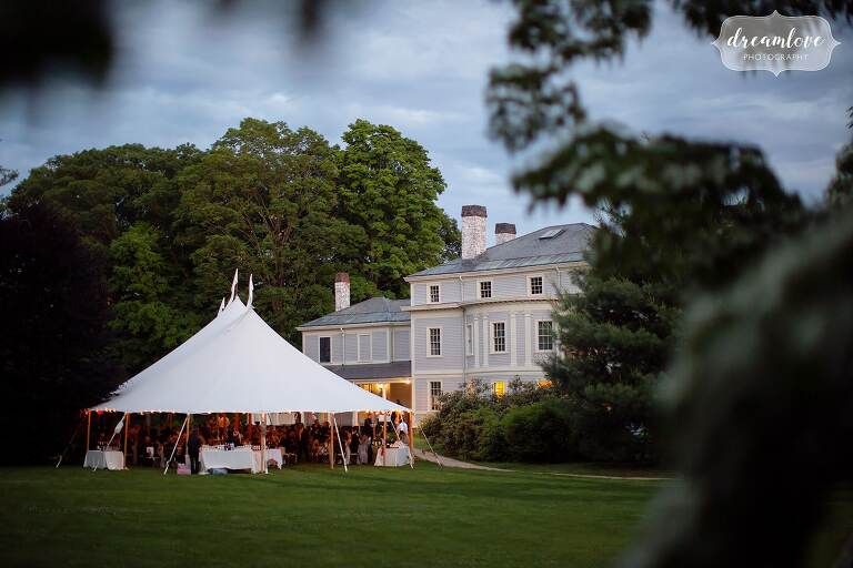 View of Lyman Estate with sailcloth tent set up for June wedding.