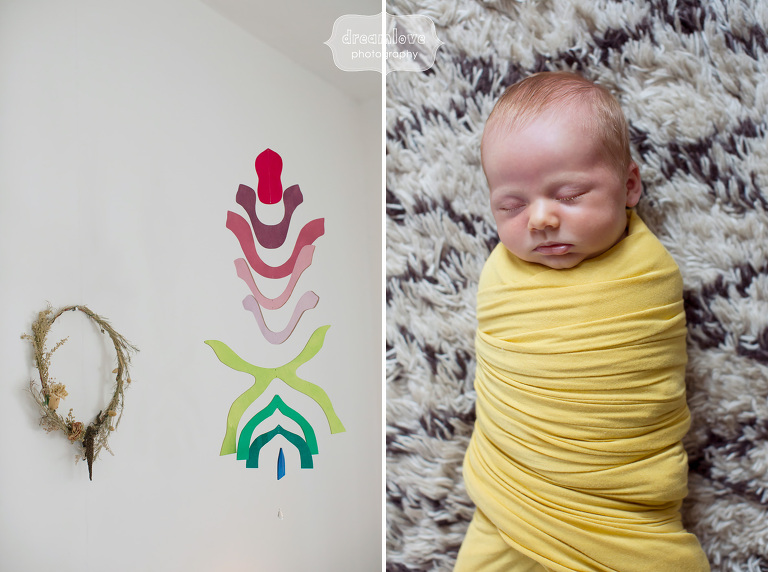 Modern baby photography in a yellow swaddle with colorful details in Venice, CA.