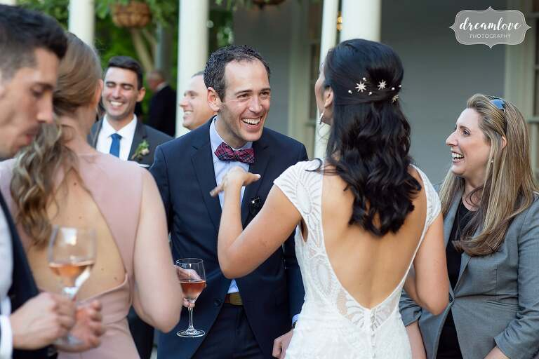 Candid photos of bride mingling with guests at Lyman Estate.