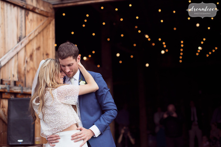The bride and groom have a romantic first dance outside at their Stowe, VT barn wedding.