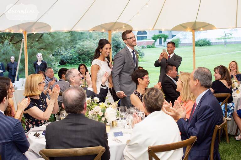 Bride and groom enter the reception tent at Lyman Estate.