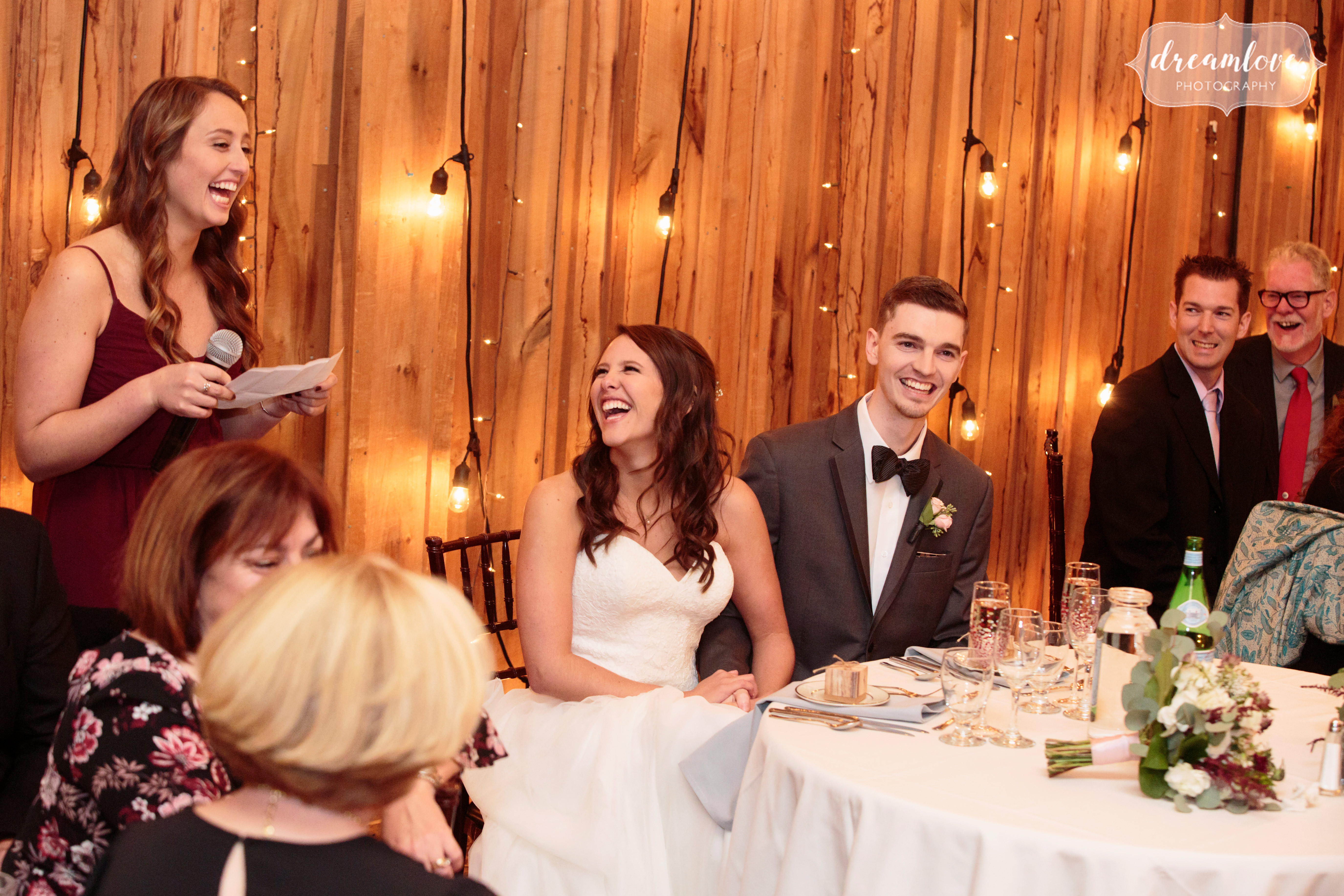 The bride laughs during maid of honor speech at the Pavilion on Crystal Lake.