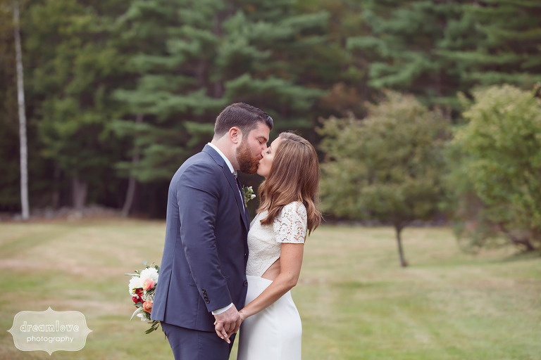 The bride and groom kiss in the field at the Curtis Hollow Farm in Quechee, VT.