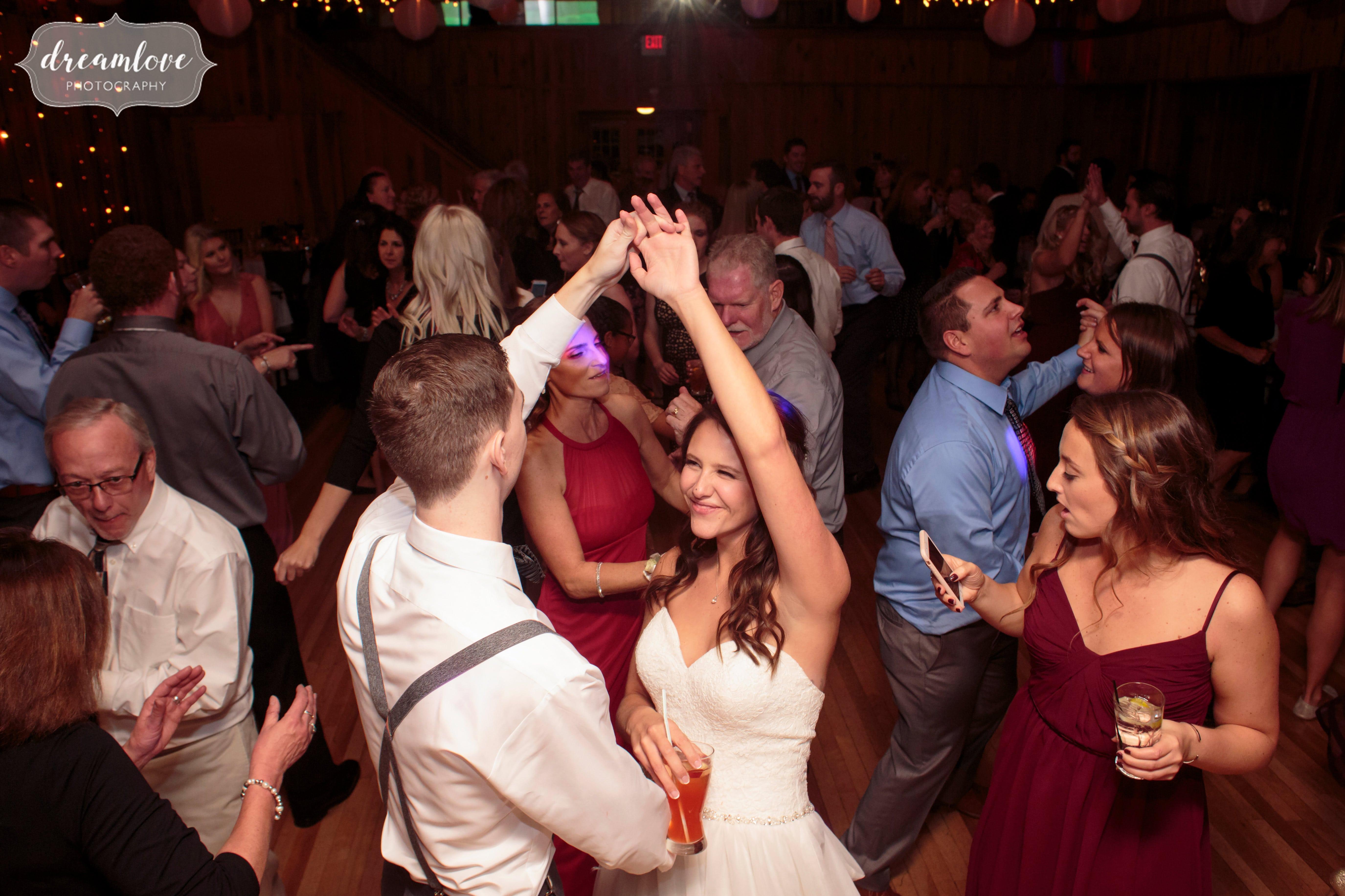 Fun wedding photography on dance floor at Crystal Lake Pavilion.