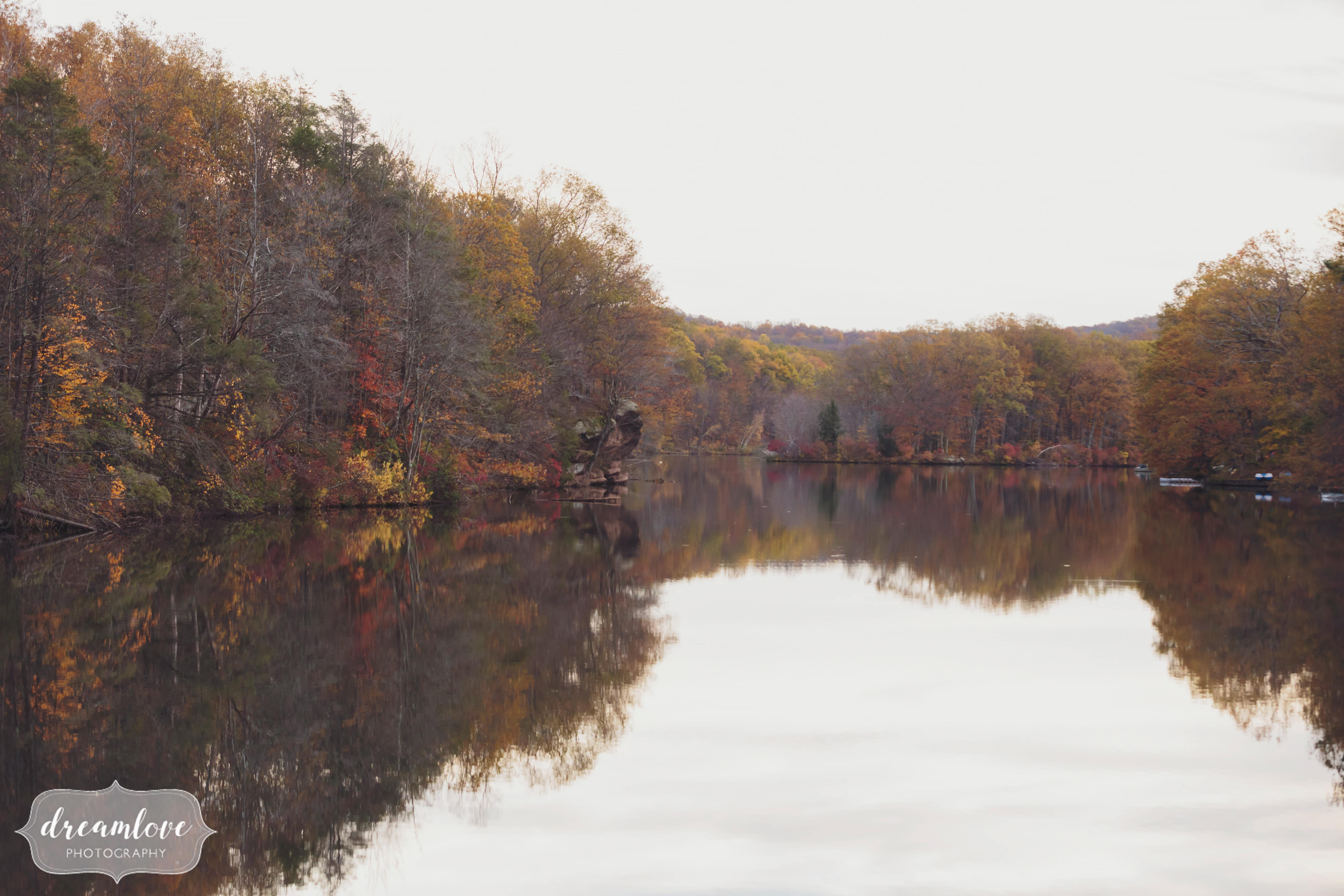 The lake surrounded by fall foliage at the Pavilion on Crystal Lake wedding venue in CT.