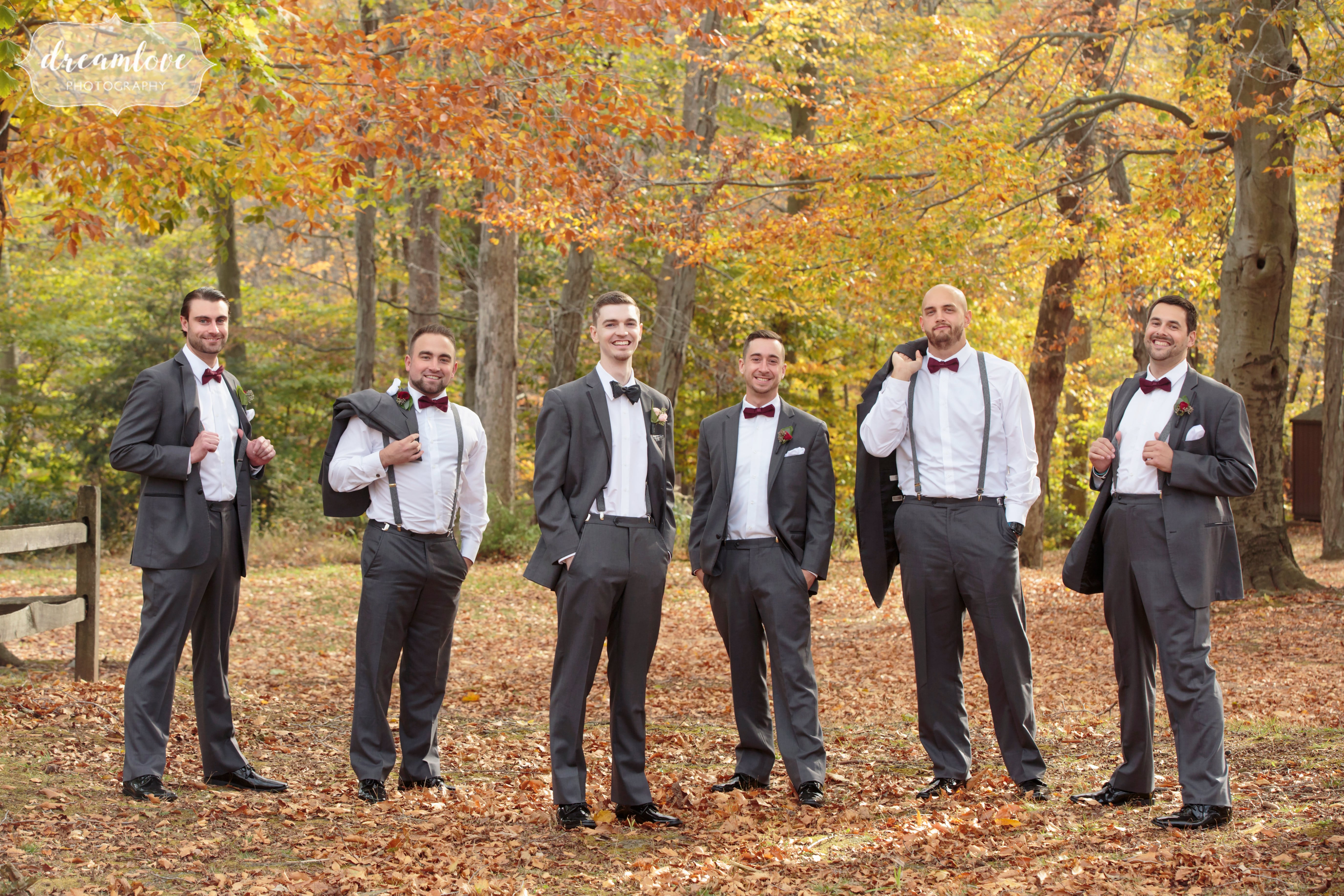 Dapper groomsmen in the woods before a Pavilion on Crystal Lake wedding in CT.