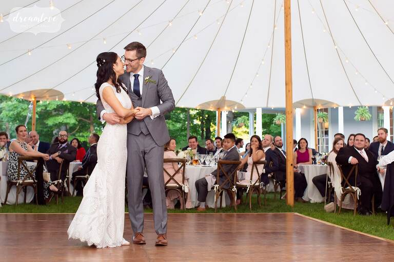 Bride and groom have their romantic first dance under Lyman Estate tent.
