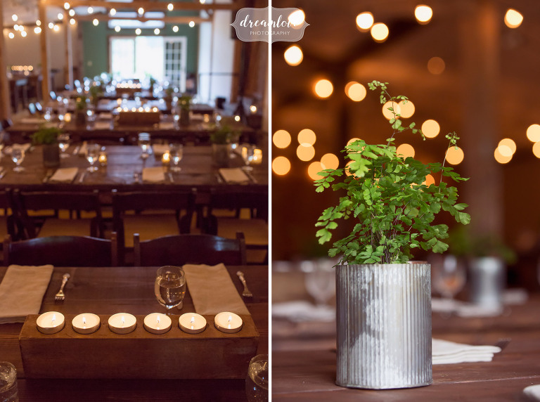 View of the inside of the Stowe Comfort Farm reception dinner space with candles and live plants.