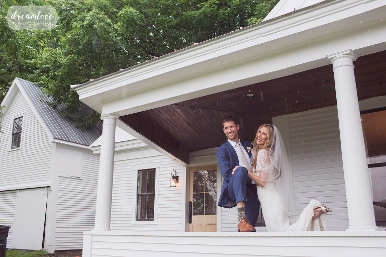 Fun wedding photos of the bride and groom on a covered porch in the rain in Stowe.