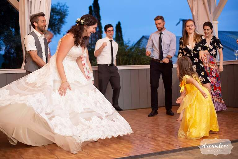 Bride dances with flower girl at Warfield House Inn.