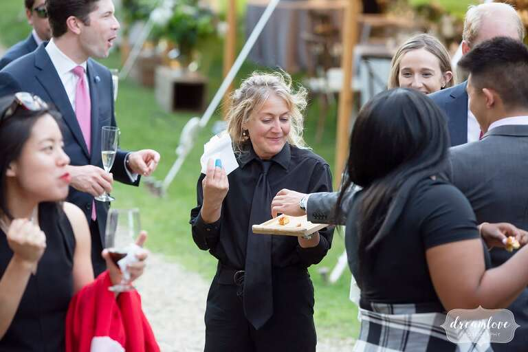 Capers Catering staff hands out mini lobster rolls at Lyman Estate.