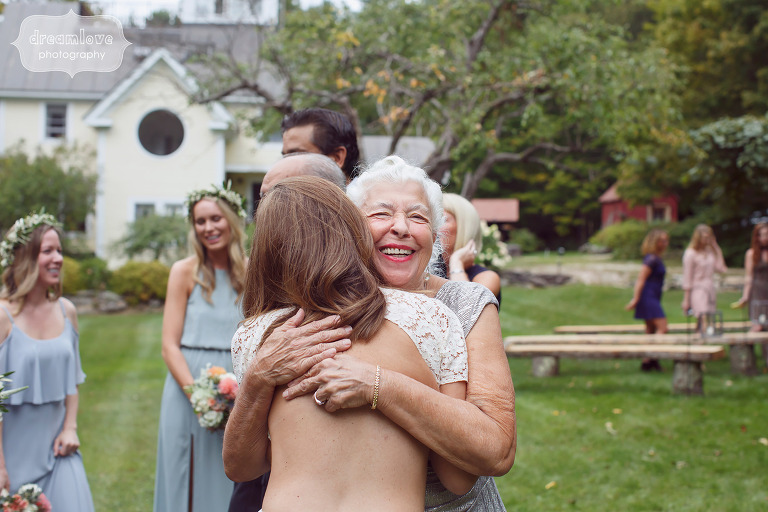 Documentary photo of the bride hugging her grandma after the ceremony in Quechee, VT.