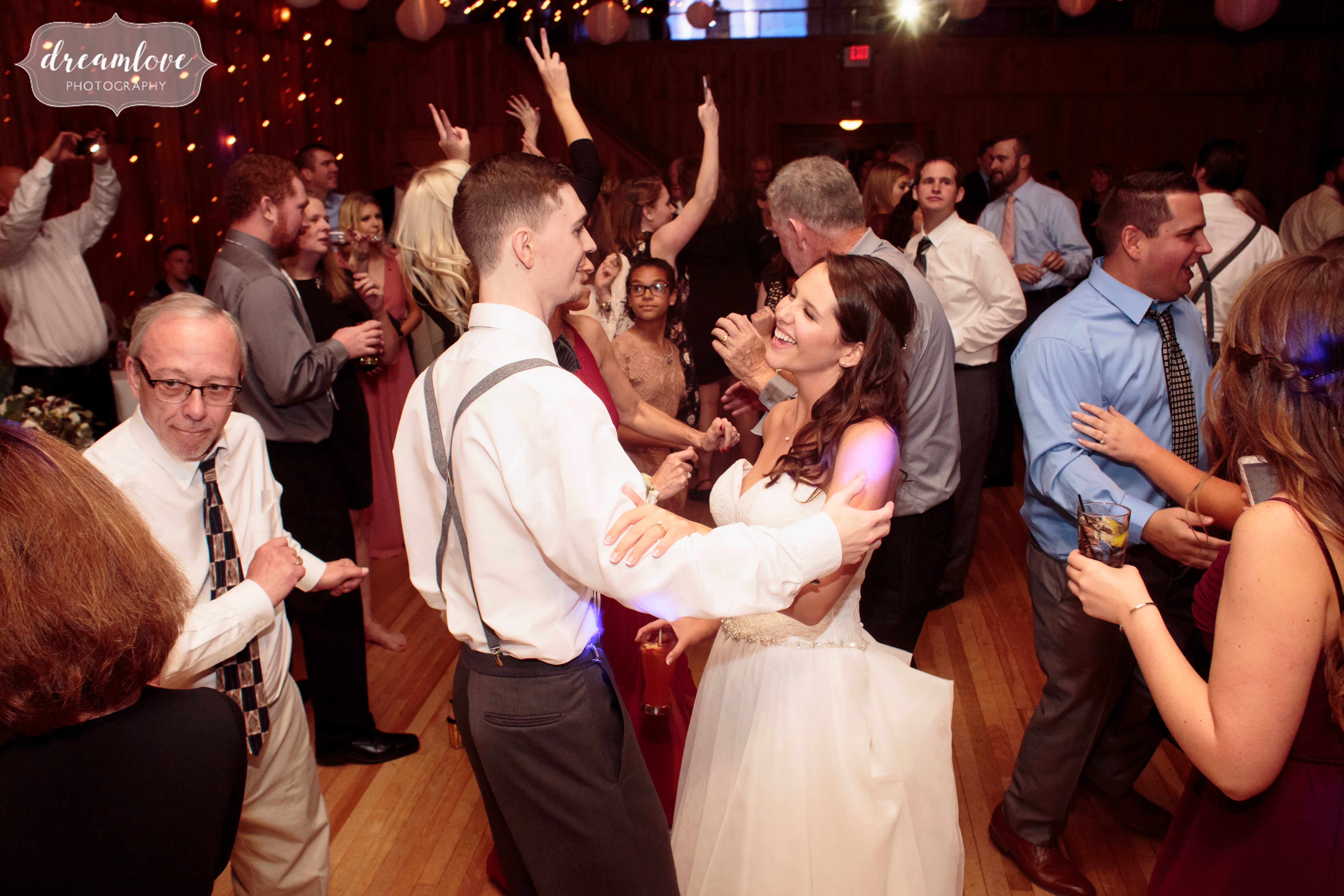 The bride and groom dance on the dance floor at the Crystal Lake Pavilion.