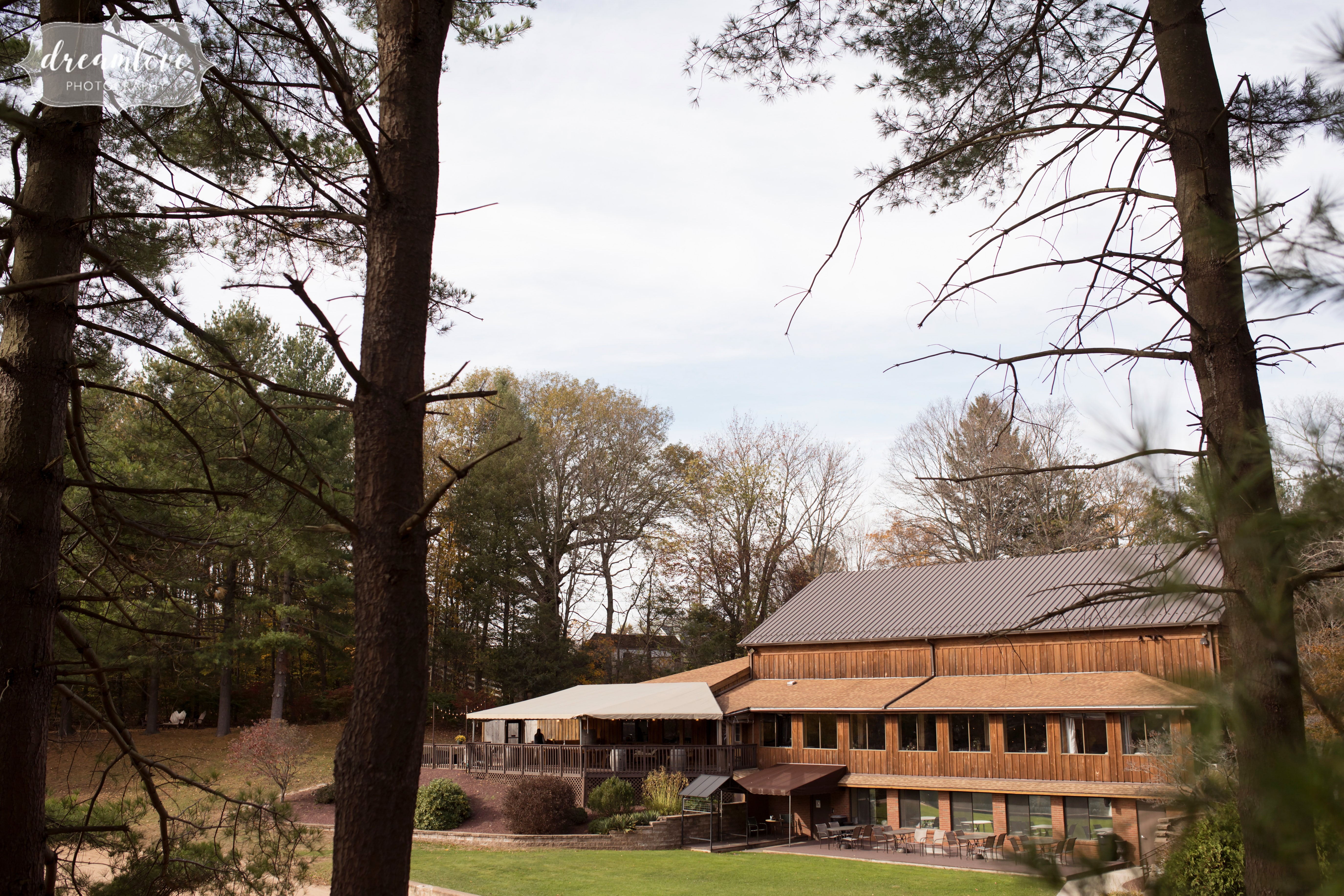 This rustic covered pavilion wedding reception venue has a lake, fall foliage, an outdoor ceremony space and is in the woods in CT!