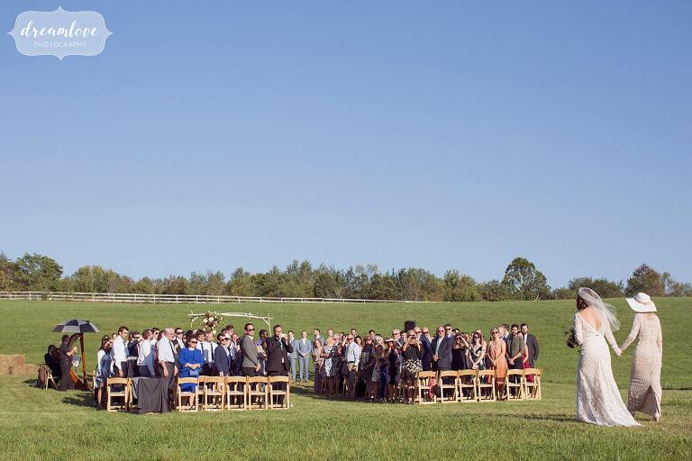 This is what an outdoor ceremony in the field looks like at the Barn at Liberty Farms wedding venue in September.