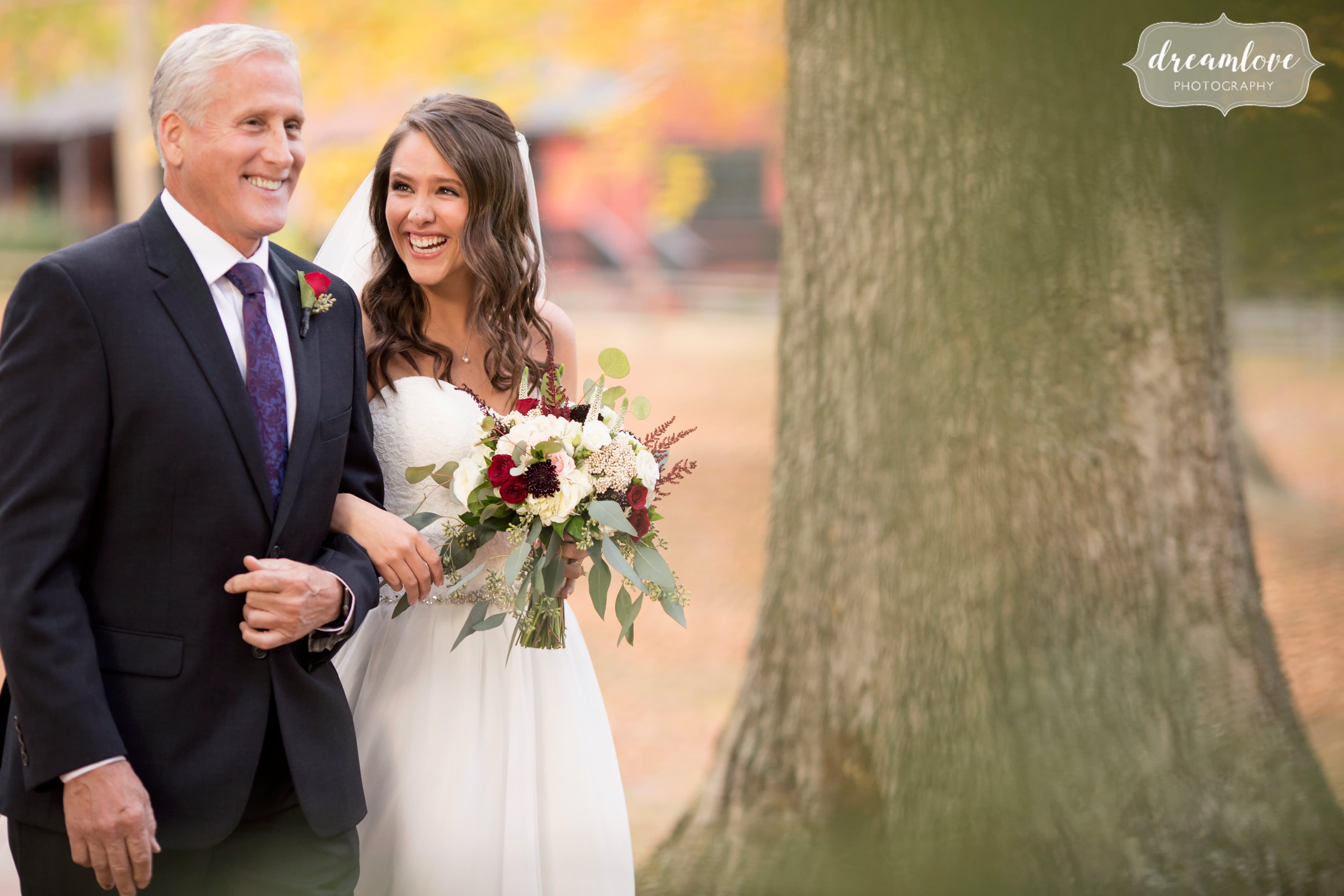 Documentary wedding photo of the bride and her dad before walking down the aisle at this outdoor woodsy wedding in Crystal Lake Pavilion.