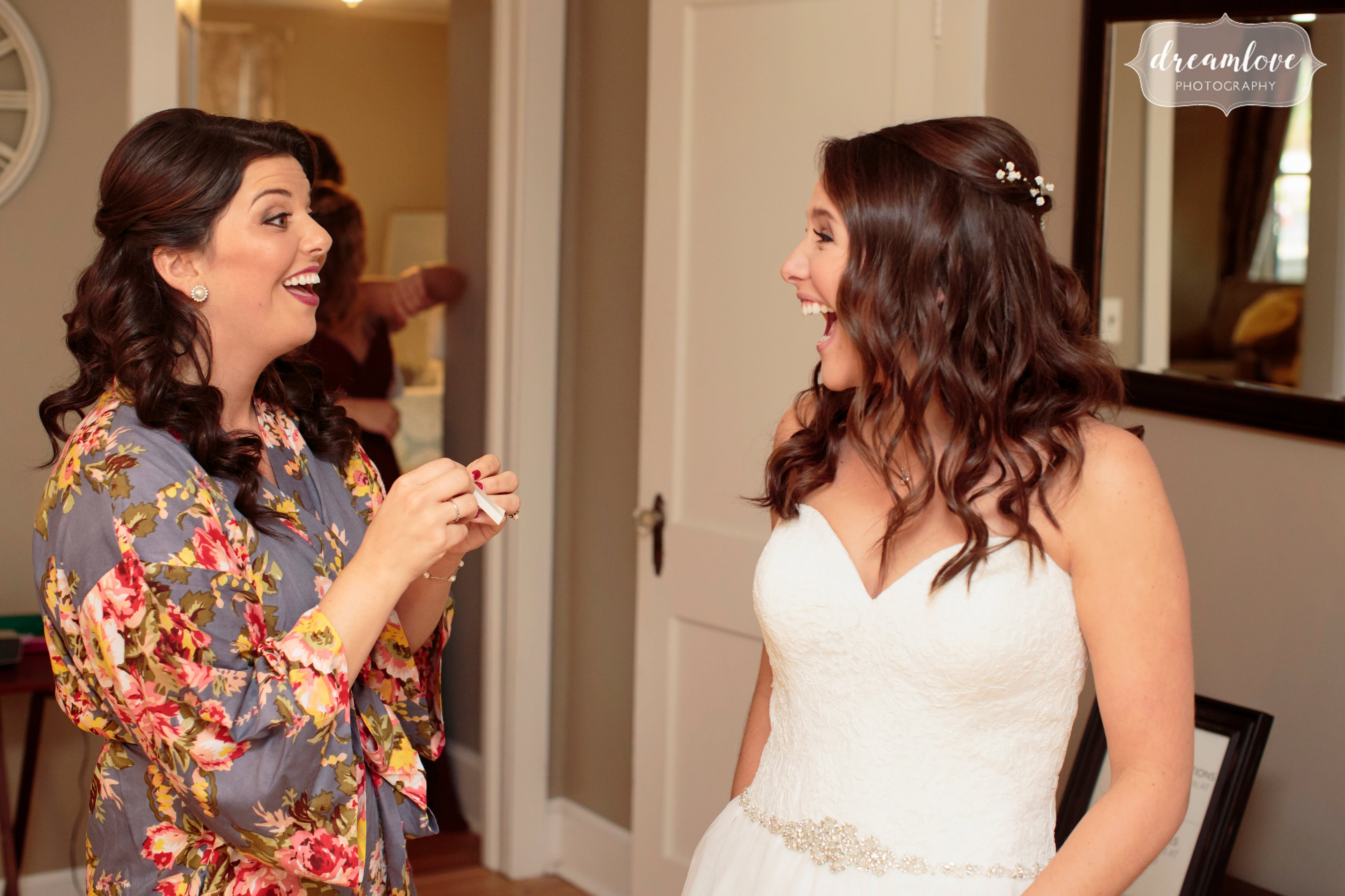 The bride gets ready for the wedding day at the Pavilion on Crystal Lake with bridesmaid in floral robe.