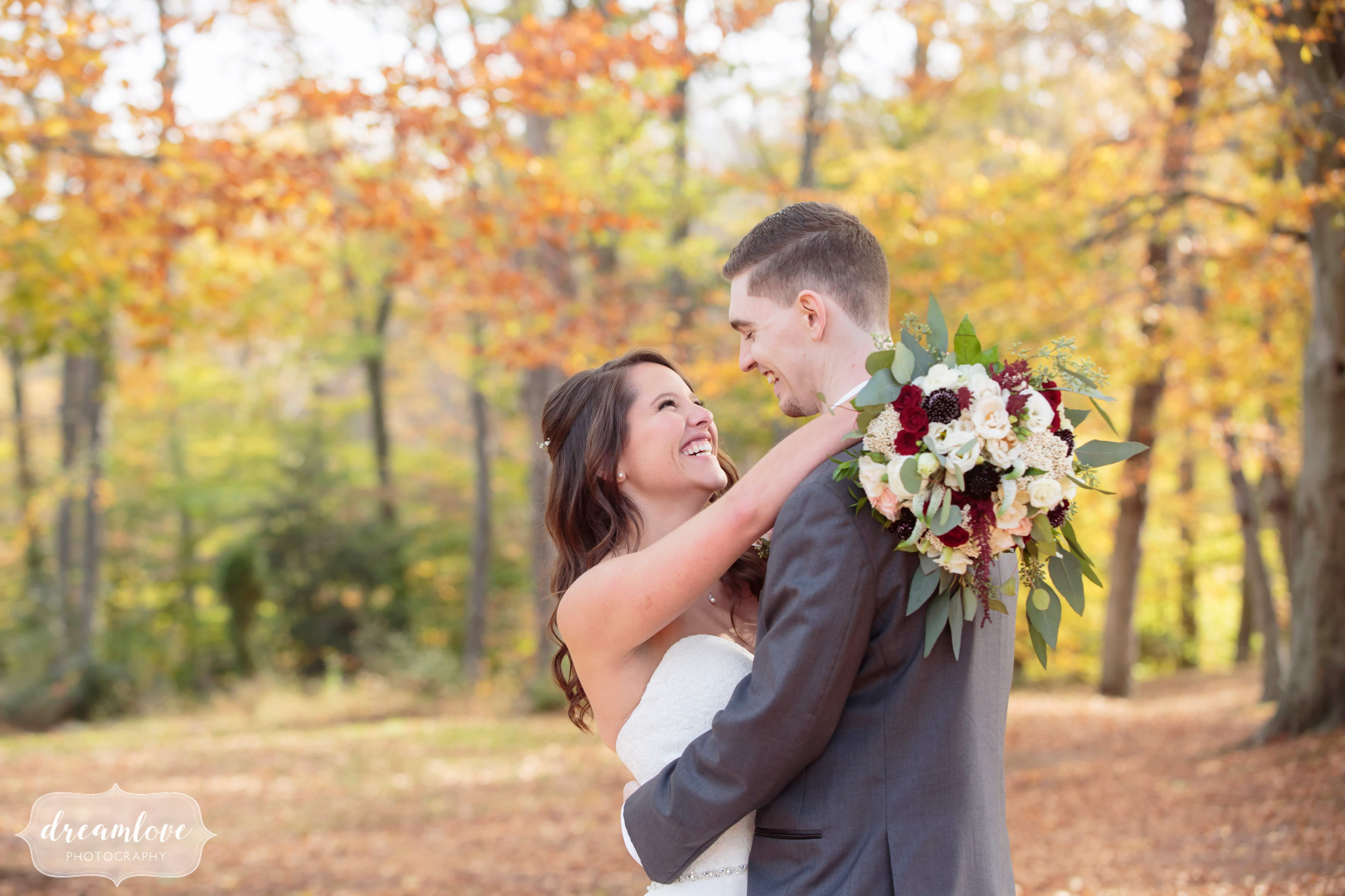Romantic and ethereal wedding photography of the bride and groom in the woods for this fall wedding in CT.