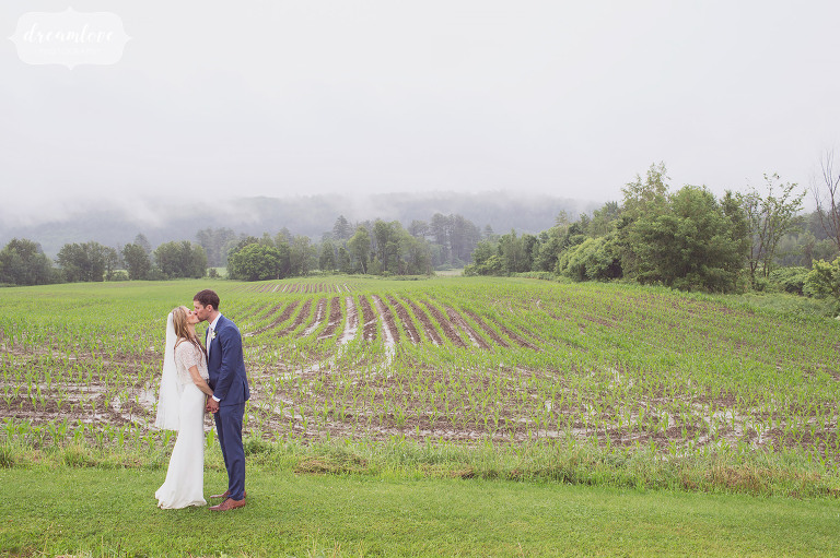 A natural wedding portrait of the bride and groom surrounded by rolling green hills along the Stowe Quiet Path.