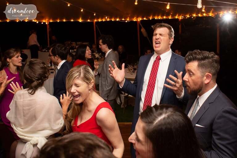 Hilarious guests sing along to wedding songs at Boston wedding.