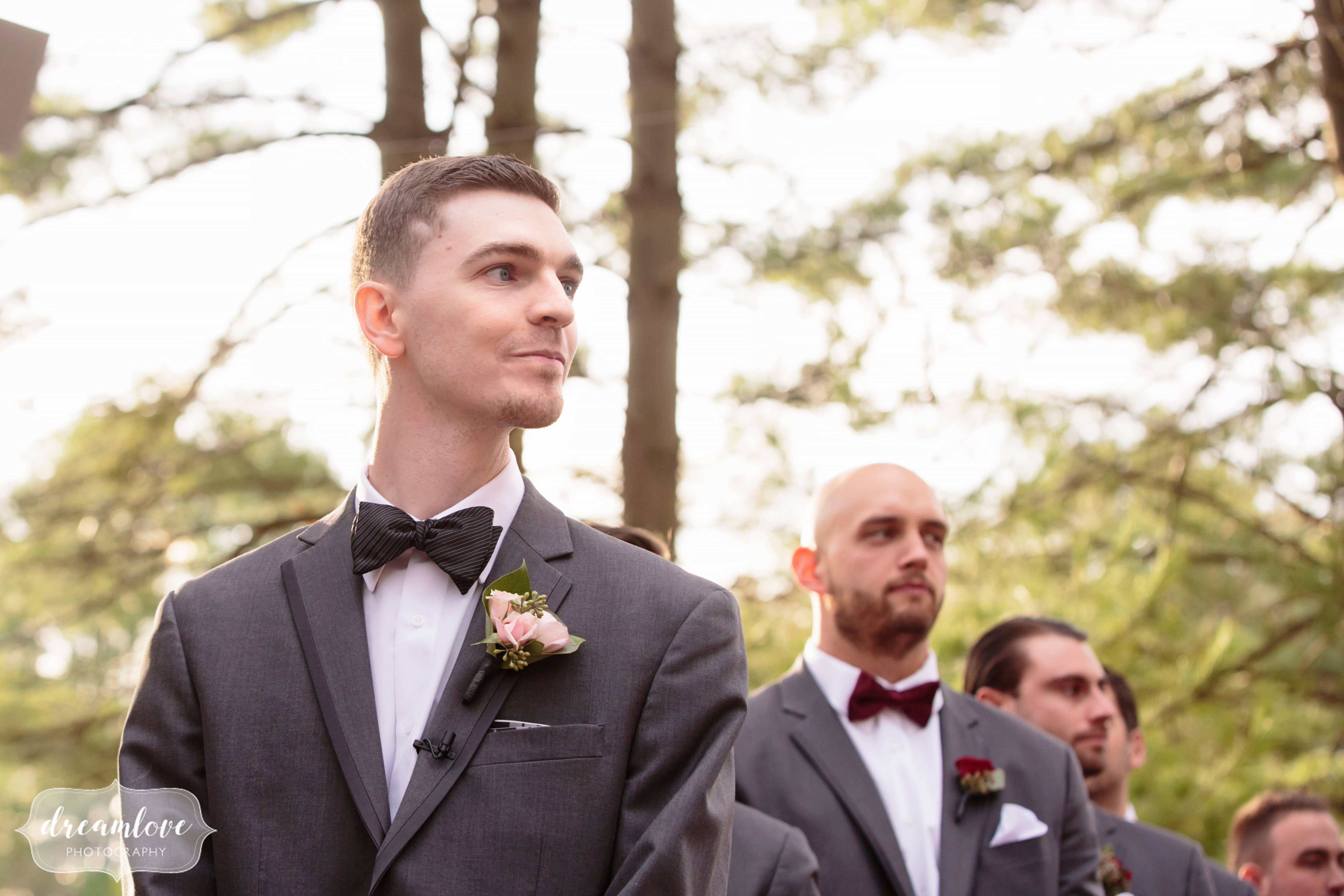 Groom watches as the bride enters ceremony at the Pavilion on Crystal Lake venue in CT.
