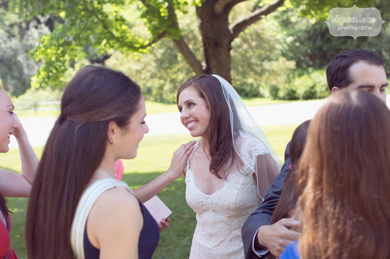Candid photo of the bride with wedding guests at the Hildene in Manchester, VT.