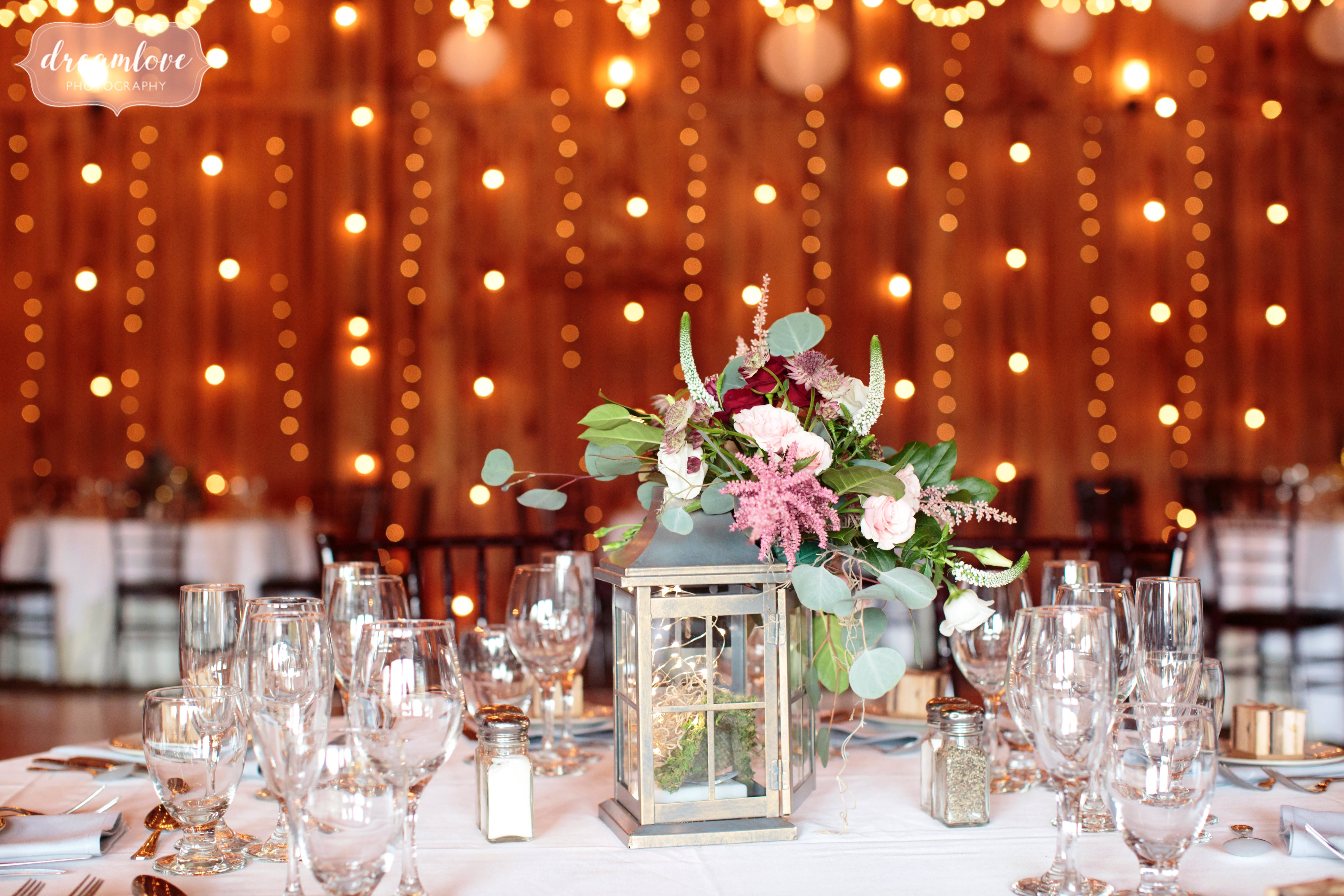 Romantic wedding decor with a twinkle lights canopy at the Pavilion on Crystal Lake.