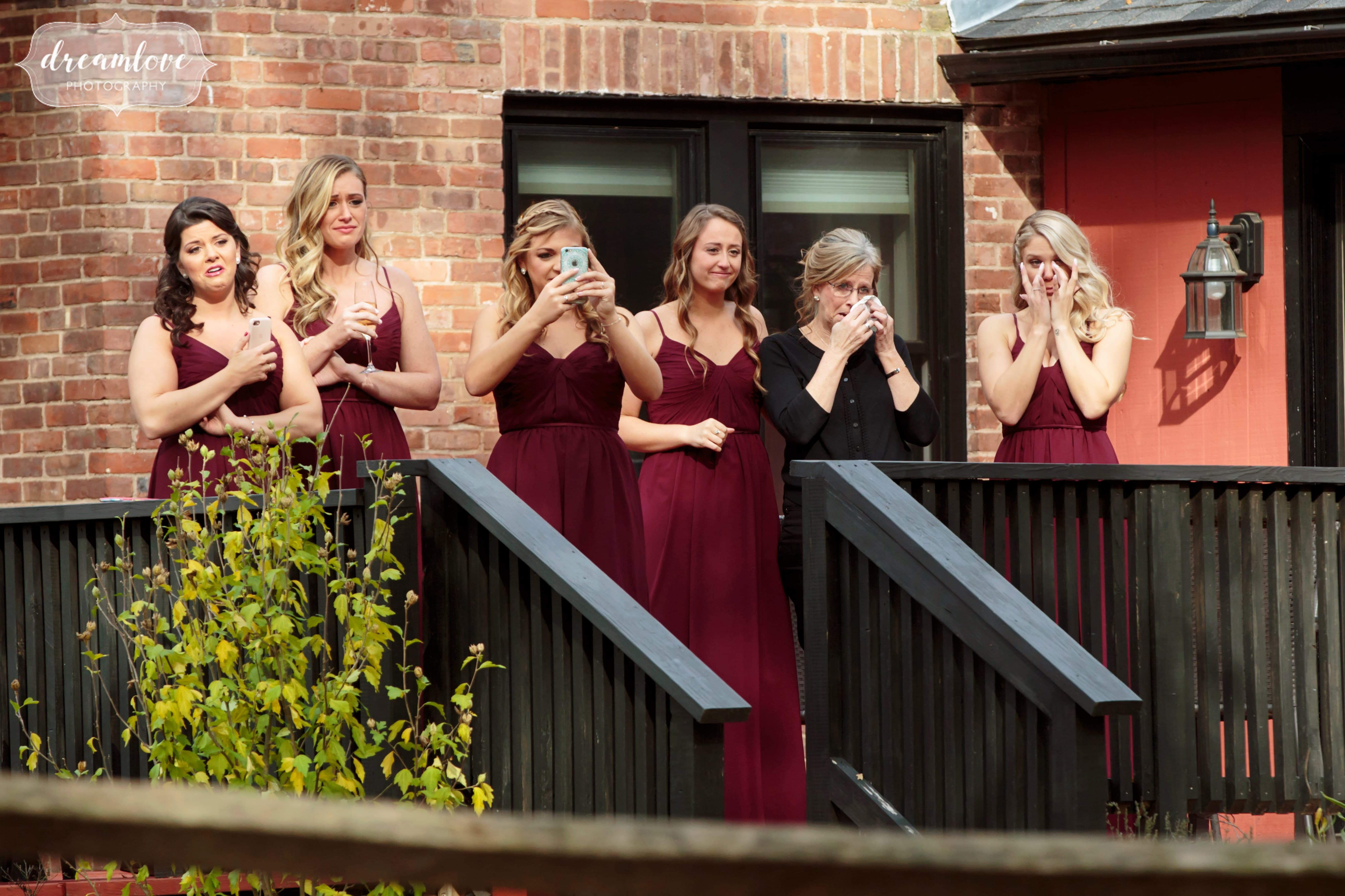 Documentary wedding photography always means we capture the sidelines and we loved this moment of the bridesmaids crying while watching the first look!