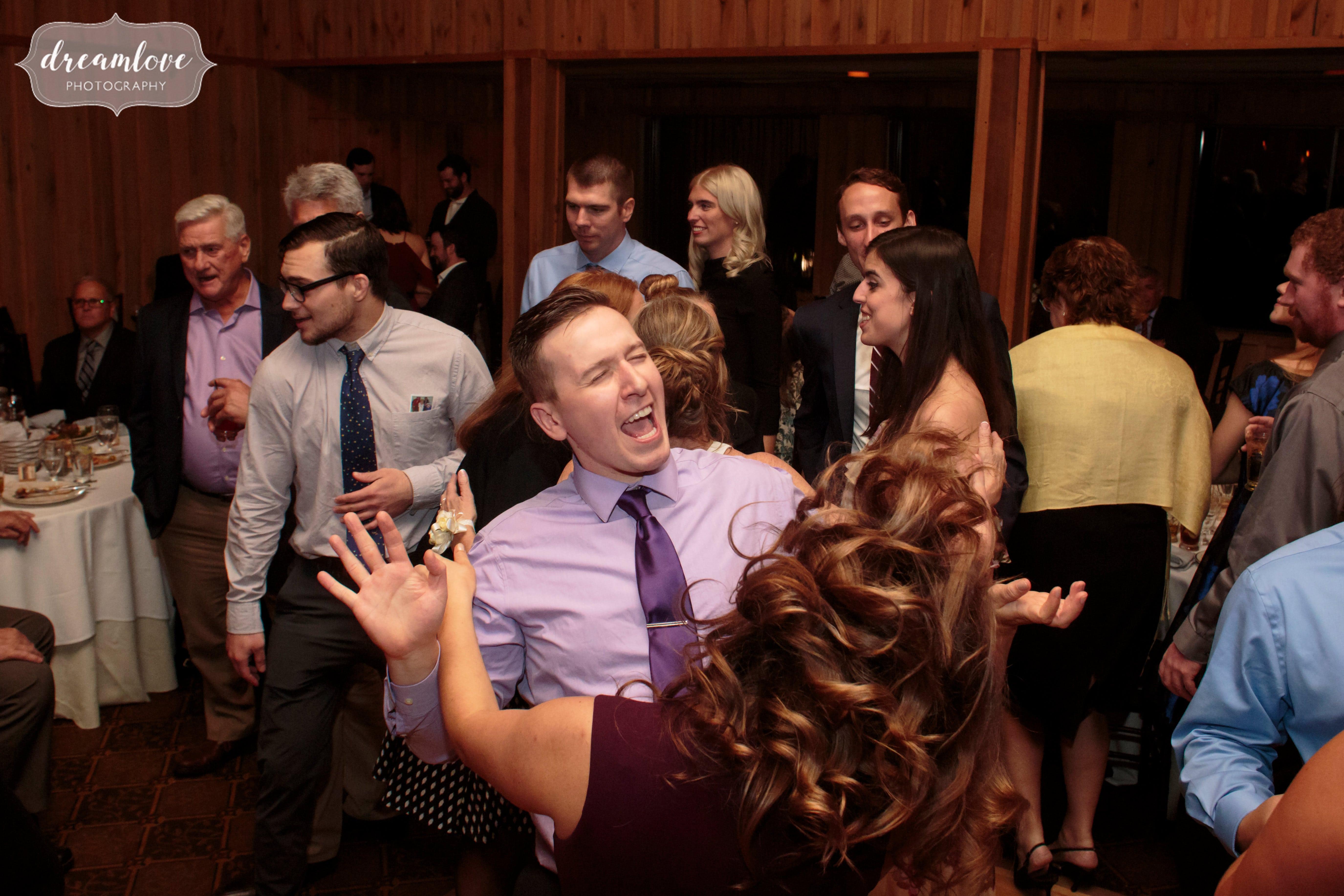 Funny wedding guests dancing at the Crystal Lake Pavilion.