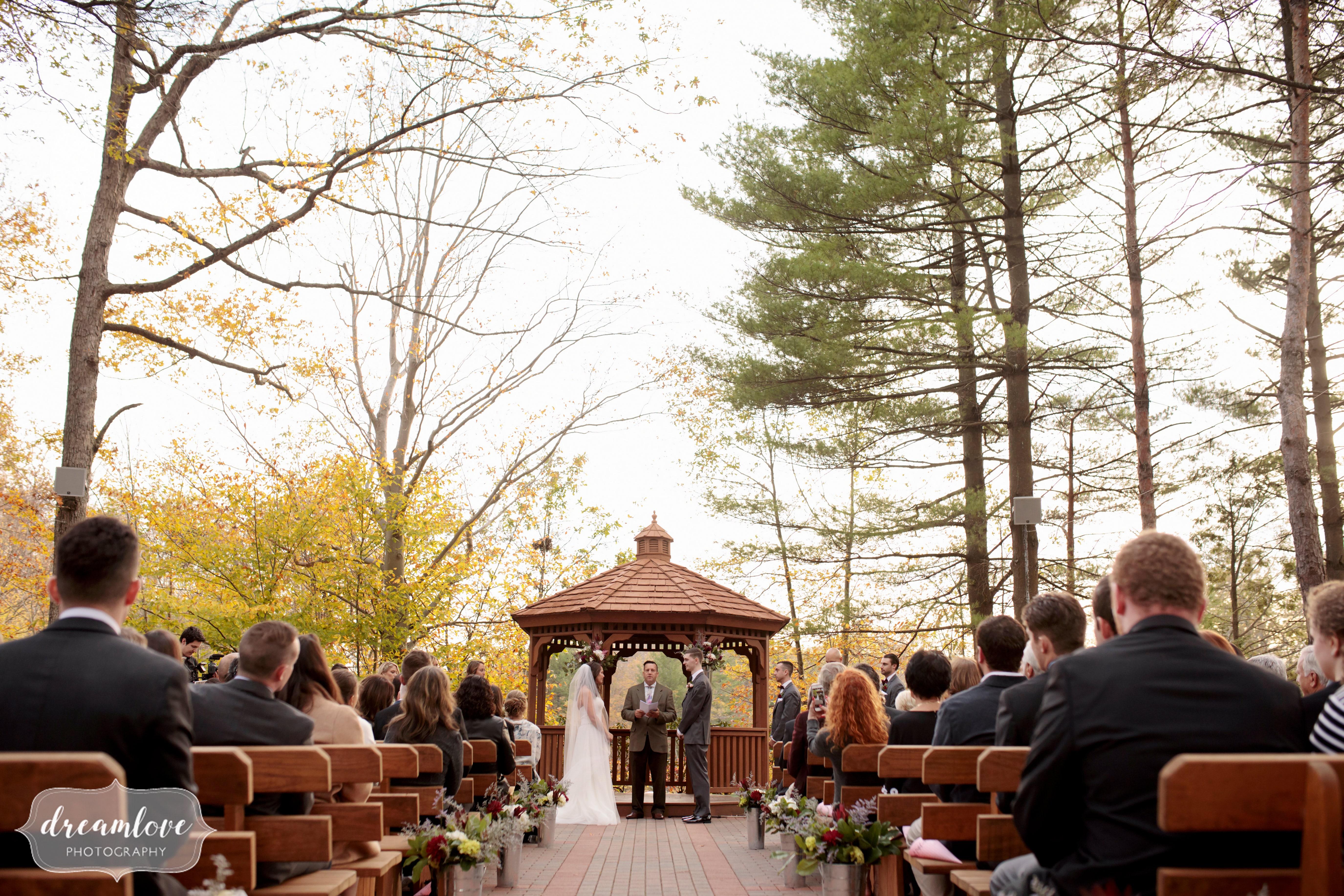 November wedding ceremony outdoors with gazebo at Crystal Lake Pavilion.