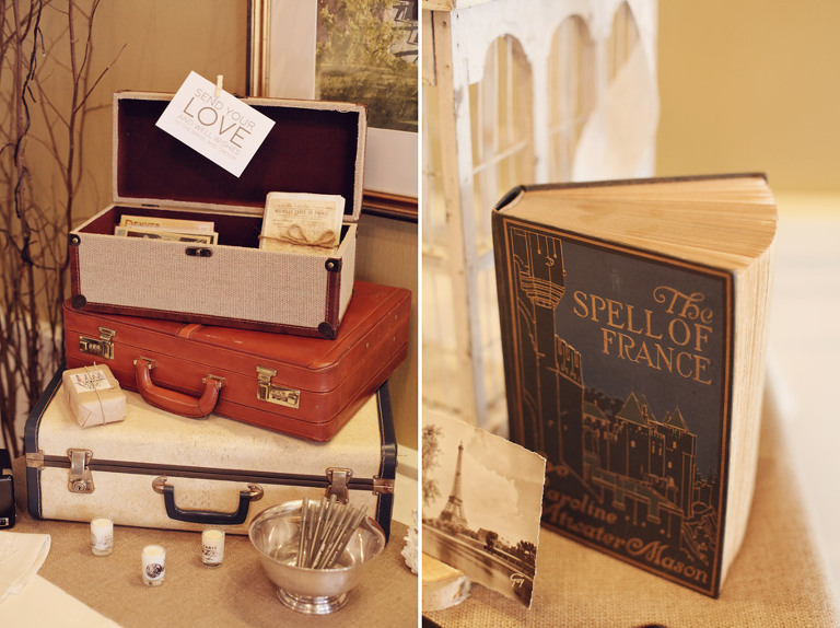 Vintage suitcases and antique books greeted guests at the reception entrance for a Woodstock Inn Winter Wedding.