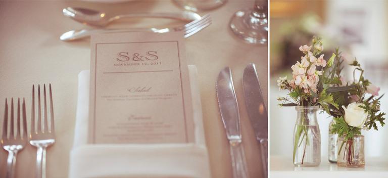 Elegant wedding dinner menu paired with simple flowers placed in vintage glass bottles.