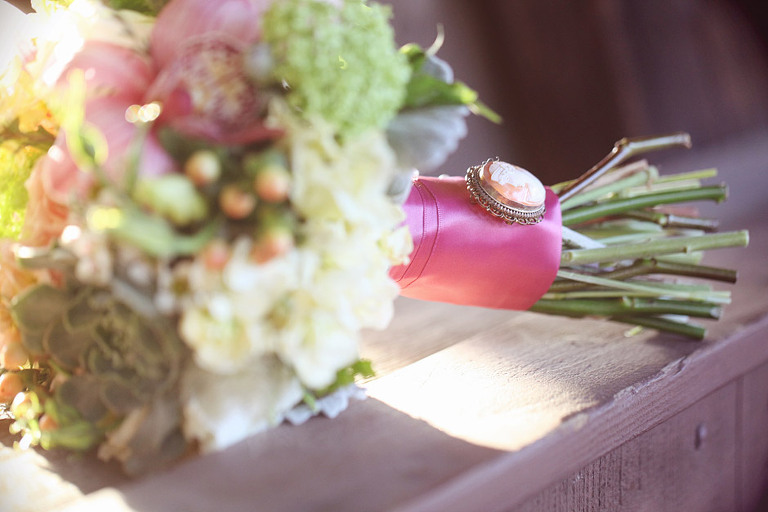 Detail picture of bridal bouquet resting on a covered bridge.