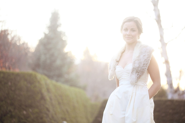 Beautiful backlit photo of a bride during her winter wedding at the Woodstock Inn.