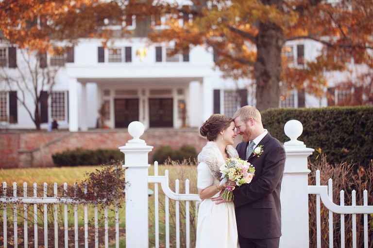 Smiling bride and groom outside in front of the Woodstock Inn.