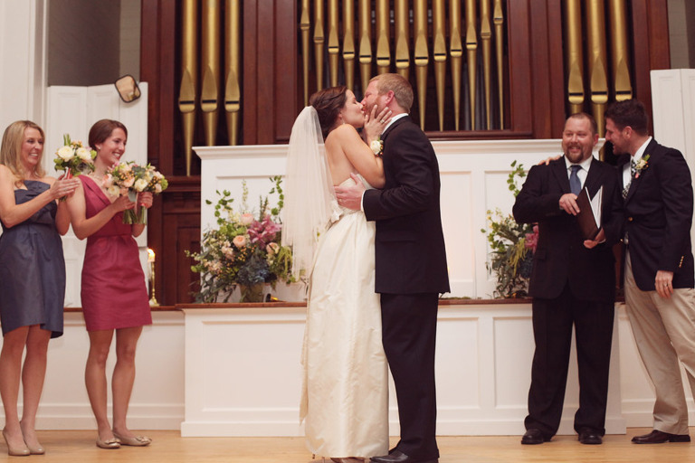 Bride and groom kiss during their wedding in Woodstock, Vermont.