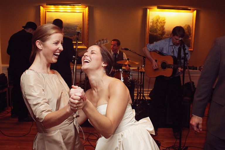 A bride and her best friend dance the night away during a winter wedding at the Woodstock Inn.