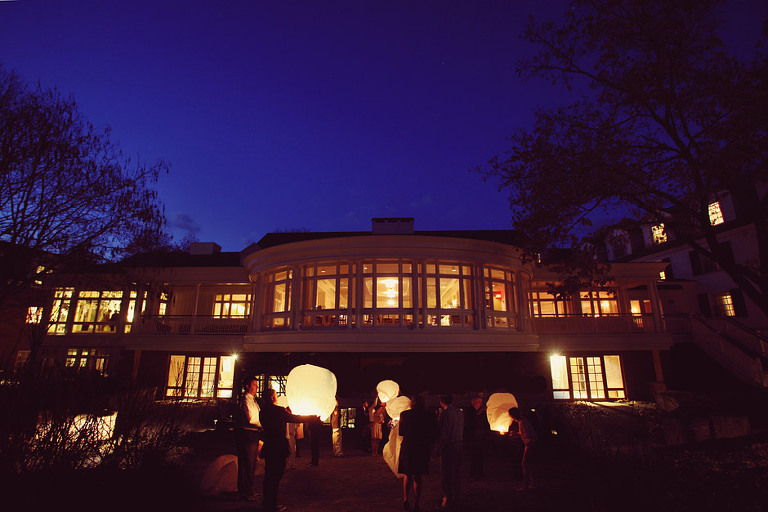 Guests prepare to release wish lanterns in the back of the Woodstock Inn.