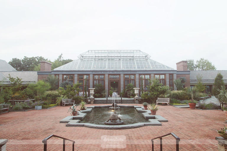 tower hill botanic garden wedding venue view of outside with fountains and greenhouse ceremony spot