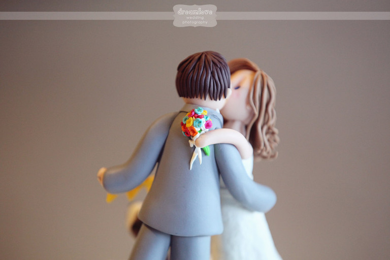 Adorable clay wedding topper with custom bride and groom figurines kissing!