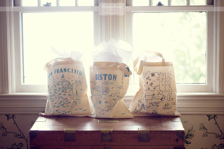 Custom maid bridesmaids gift totes near a window while getting ready for a wedding.