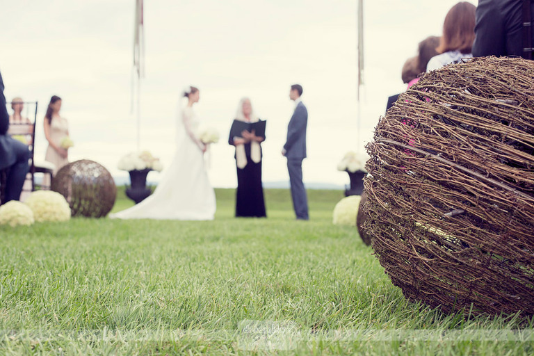 Detail of aisle decor at at Krissy and Sean's Lake Champlain wedding at Shelburne Farms in Vermont.