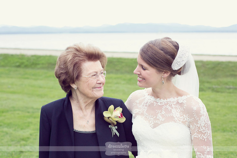 A bride and her grandmother smile at each other following an elegant wedding at Shelburne Farms.