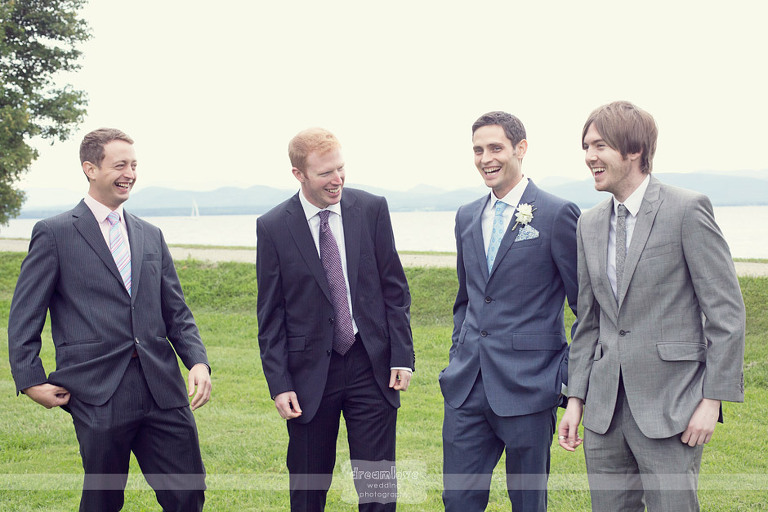 A groom and his friends laugh during the cocktail hour.