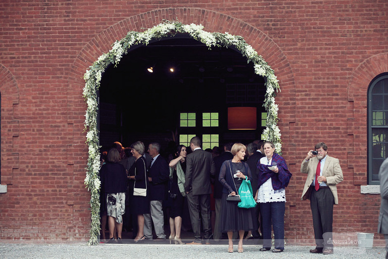Guests mingle during the cocktail hour at Coach Barn in Shelburne Farms.