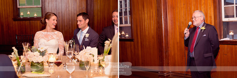 A newly married couple laughs during speeches at their elegant Shelburne Farms wedding.