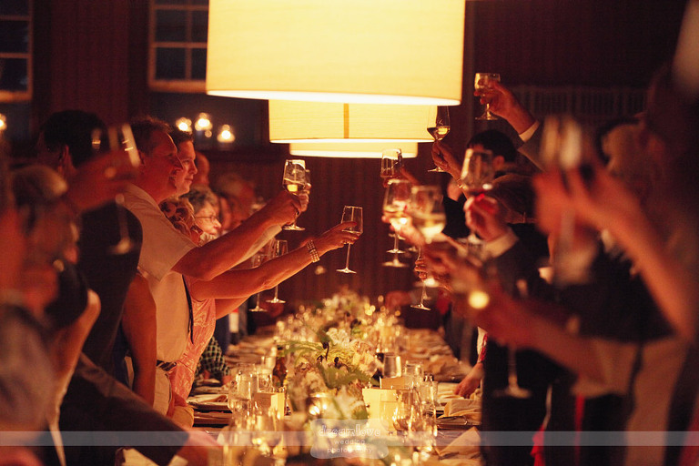 Wedding guests cheers during the best man speech at a Shelburne Farms wedding.