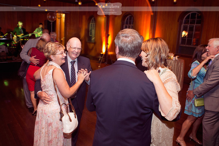 Couples laugh and dance during a wedding reception at Shelburne Farms.