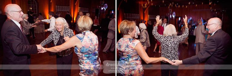 Couples laugh and dance during a wedding reception.