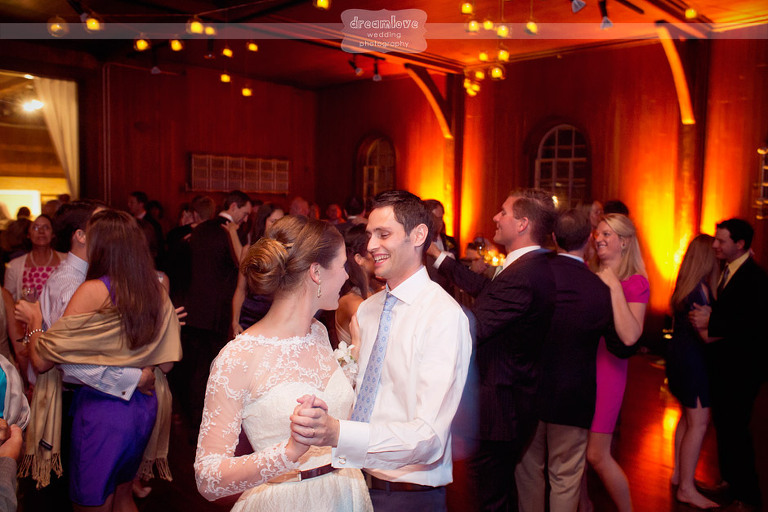 A bride and groom celebrate during their reception at the Shelburne Farms.